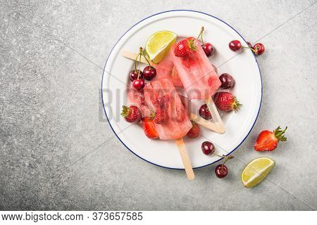 Berry Popsicle With Wooden Sticks On Concrete Counter. Homemade Strawberry Frozen Fruit Bars Berry P