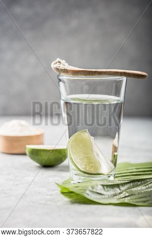 Collagen Powder And Glass Of Water With  Slice Of Lime; Vitamin C . Collagen Supplements May Improve