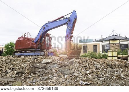 Crawler Bulldozer Over The Rubble Of A Building In The Residential Area - Crawler Excavator Machine
