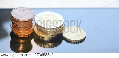 Stacks Of Coins Reminding Column Diagram Going Down, Finance And Banking Loss Concept. Copy Space Fo