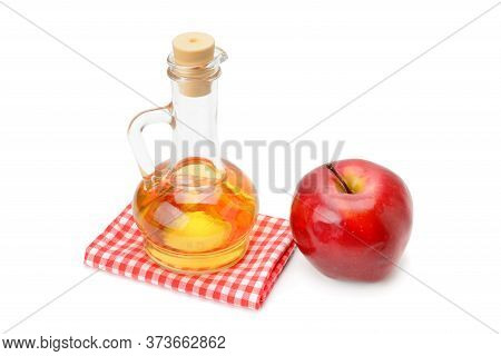 Apple Cider Vinegar In A Glass Vessel Isolated On White Background