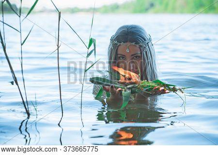 Mermaid Girl Bride In White Dress In Lake. Fantasy Girl. Mysterious Scene. Witch Standing In The Riv