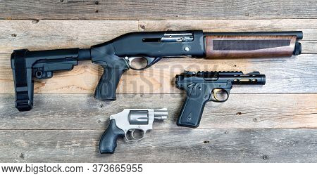 Home Security Shotgun,revolver And Semi Automatic Pistol.