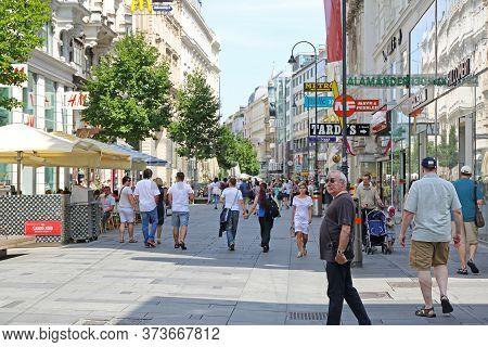 Vienna, Austria - July 12, 2015: Tourists At Karntner Shopping Street Summer In Vienna, Austria.