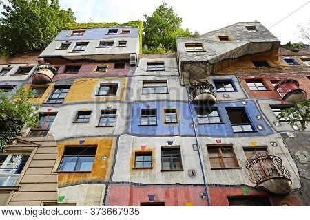 Vienna, Austria - July 12, 2015: Famous Colourful Organic Apartment Buildings By Architect Hundertwa