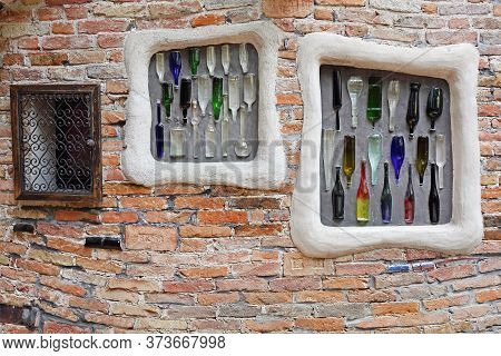 Vienna, Austria - July 12, 2015: Colourful Glass Bottles In Wall At Kunst Haus Cafe Famous Building