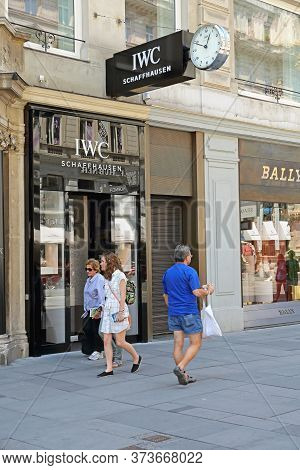 Vienna, Austria - July 12, 2015: People Walking In Front Of Iwc Schaffhausen Clock Shop At Graben St