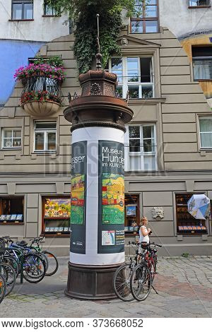 Vienna, Austria - July 12, 2015: Kunst Haus Museum Column In Front Of Famous Organic Apartment Build