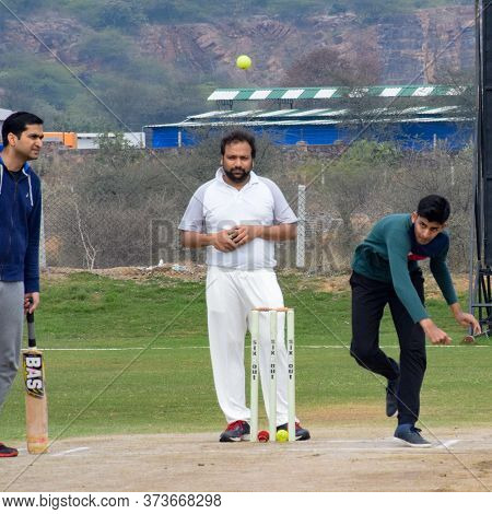 New Delhi India - March 3 2020 : Full Length Of Cricketer Playing On Field During Sunny Day In Local