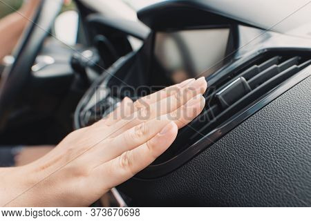 Car Air Conditioning. Woman Checks Air Conditioning In A Car