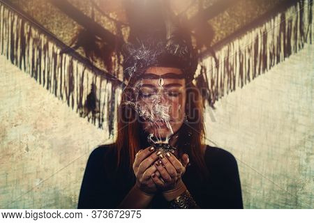 Incense In A Woman Hand, Incense Smoke On A Black Background.