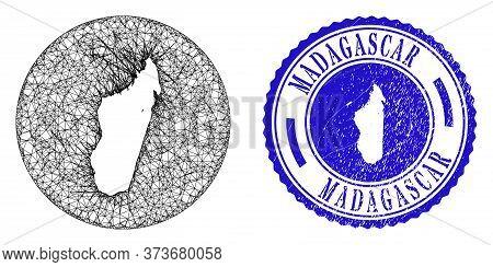 Mesh Hole Round Madagascar Island Map And Scratched Seal Stamp. Madagascar Island Map Is A Hole In A