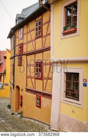 Picturesque Cobblestone Street With Colorful Half Timbered Medieval Houses. Loket, Czech Republic -