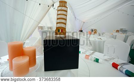 Served Table With Italy Topic Decorated By Flags And Leaning Tower Of Pisa