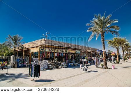 Luxor, Egypt - Jan 28, 2020: Tourists shops at the enter of Luxor Temple in Luxor, ancient Thebes, Egypt. Luxor Temple is a large Ancient Egyptian temple complex located on the bank of the Nile river
