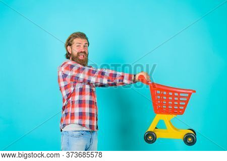 Supermarket. Shopping. Sale. Discount. Black Friday. Buying. Bearded Man With Empty Shopping Cart. M