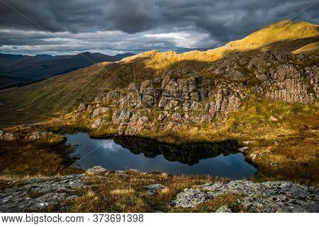 Dramatic Scottish Highlands Landscape. Little Pond And Rocky Features Near Beinn A'chroin, Mountain