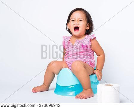 Asian Little Cute Baby Child Girl Education Training To Sitting On Blue Chamber Pot Or Potty With To