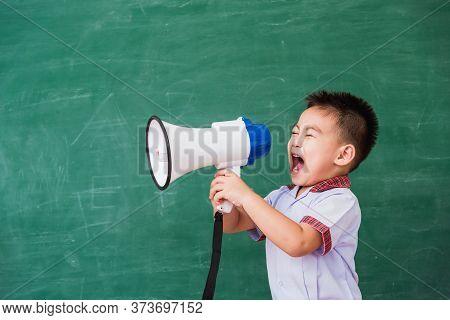 Back To School. Asian Funny Cute Little Child Boy Kindergarten Preschool In Student Uniform Speaking