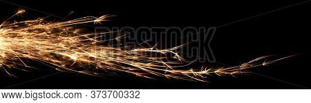 Waves of light trails of hot glowing embers from a 4th of July sparkler firework.