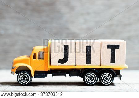 Truck Hold Letter Block In Word Jit (abbreviation Of Just In Time)  On Wood Background