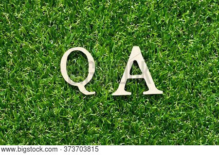 Wood Alphabet Letter In Word Qa (abbreviation Of Quality Assurance Or Question And Answer) On Green