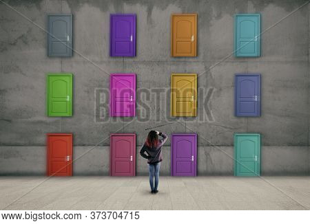 Multiple Doors With Different Colors On A Wall .  Difficult Decision Concept .