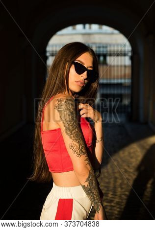 Relaxed Attractive Sexy Girl. Youth Fashion. Feeling Free And Stylish. Girl Wear Fashion Clothes For