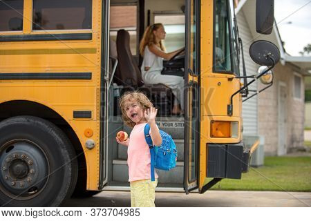 Cute Pupils Smiling At Camera In The School Bus Outside The Elementary School. Back To School And Ha