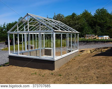 Classical Metal And Glass Backyard Garden Greenhous Under Construction