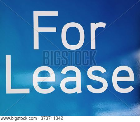 Blue For Lease Sign With White Lettering On Blue Background
