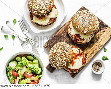Homemade Whole Grain Bun, Grilled Chicken, Tomato Sauce, Mozzarella Cheese Burgers On The Cutting Bo