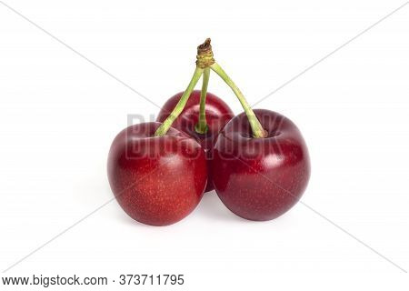 Ripe Sweet Cherry Isolated On White Background. Juicy Summer Fruit.