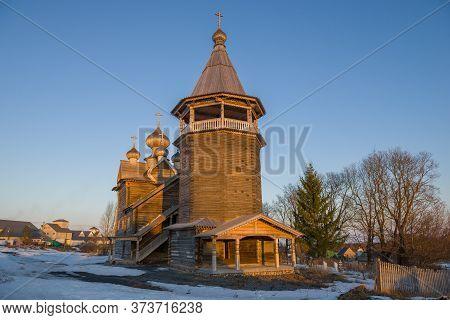 Old Wooden Church Of Dmitry Solunsky Close Up On A Sunny April Evening. Village Shcheleiki, Leningra