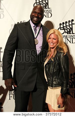 NEW YORK-SEPT. 24: Shaquille O'Neal and Jill Martin attend the 27th annual Great Sports Legends Dinner for the Buoniconti Fund at the Waldorf-Astoria on September 24, 2012 in New York City.