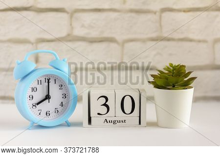 August 30 According To The Wooden Calendar. Summer Day, Empty Space For Text.calendar For August On