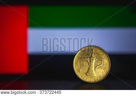 United Arab Emirates Dirham - One Dirham Coin Of Uae Isolated On United Arab Emirates Flag Backgroun