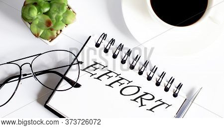 Effort Text On Notepad With Glasses And Cup Of Coffee