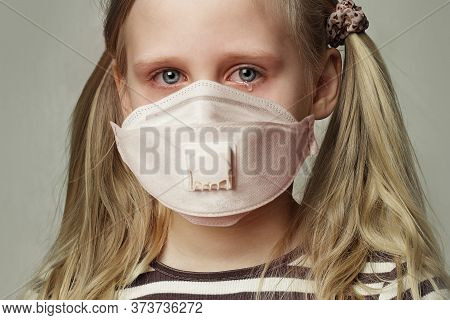Child Girl In Protective Medical Mask Crying, Closeup Portrait