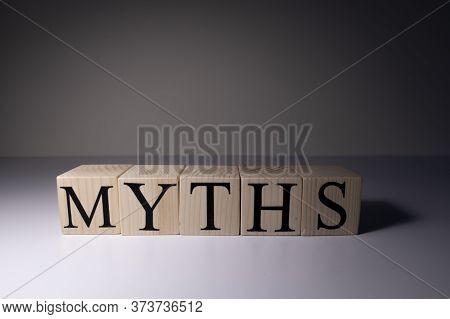 Myths Word Written On Wood Block. Myths Text On Table, Concept.