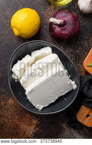 Traditional Feta Cheese In Black Bowl Top View.