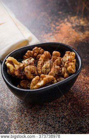 Walnuts Nuts In Black Bowl Side View.