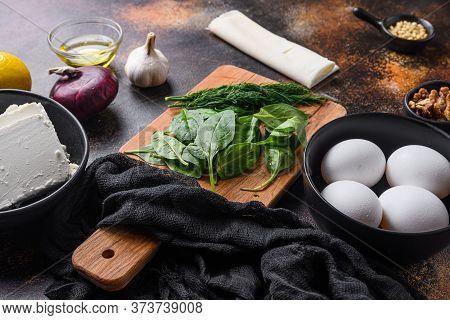 Traditional Greek Spanakopita Ingredients Filo Spinach Eggs Feta Side View.