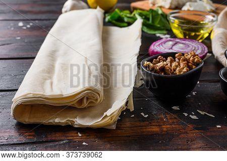 Greek Spanakopita Ingredients Filo Spinach Eggs Feta Side View On Dark Wooden Background