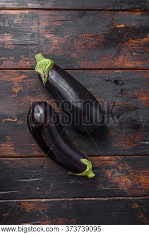 Fresh Healthy Raw Purple Eggplant On A Kitchen Old Dark Wooden Table. Top View.