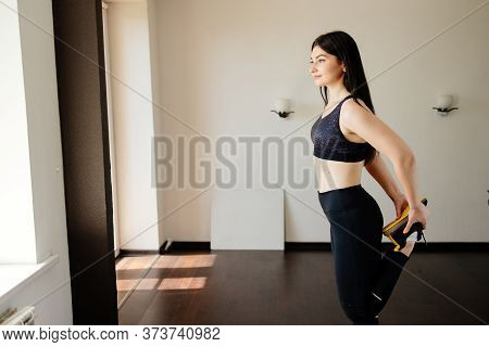 Home Training, Sport, Leisure Activity. Fit Woman Doing Stretching Exercise Warming Up Muscles Befor