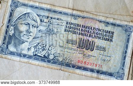 Obverse Of 1000 Dinar Paper Bill Issued By Yugoslavia That Shows Portrait Of Woman And Agriculture