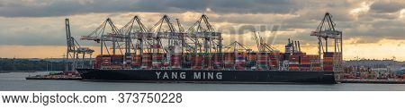 Southampton, Uk - June 11, 2020: Panoramic Aerial View Of Huge Container Ship Yang Ming Being Loaded