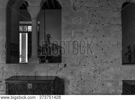 Segovia. Spain. - October 19, 2017: Knight Armors Behind Windows In The Alcazar Of Segovia. Spain.