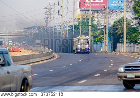 Samut Sakhon, Thailand - May 2020: Pm2.5 On City Traffic,truck Emits Black Smoke While Running On Th